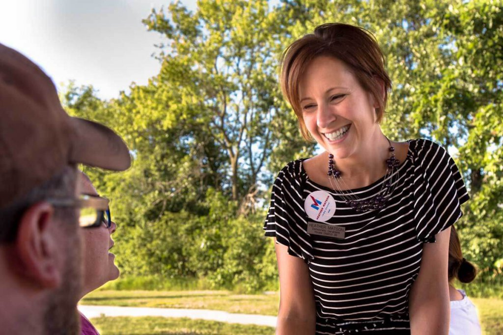 Photo of Iowa State Representative Heather Matson speaking to voters at a picnic.