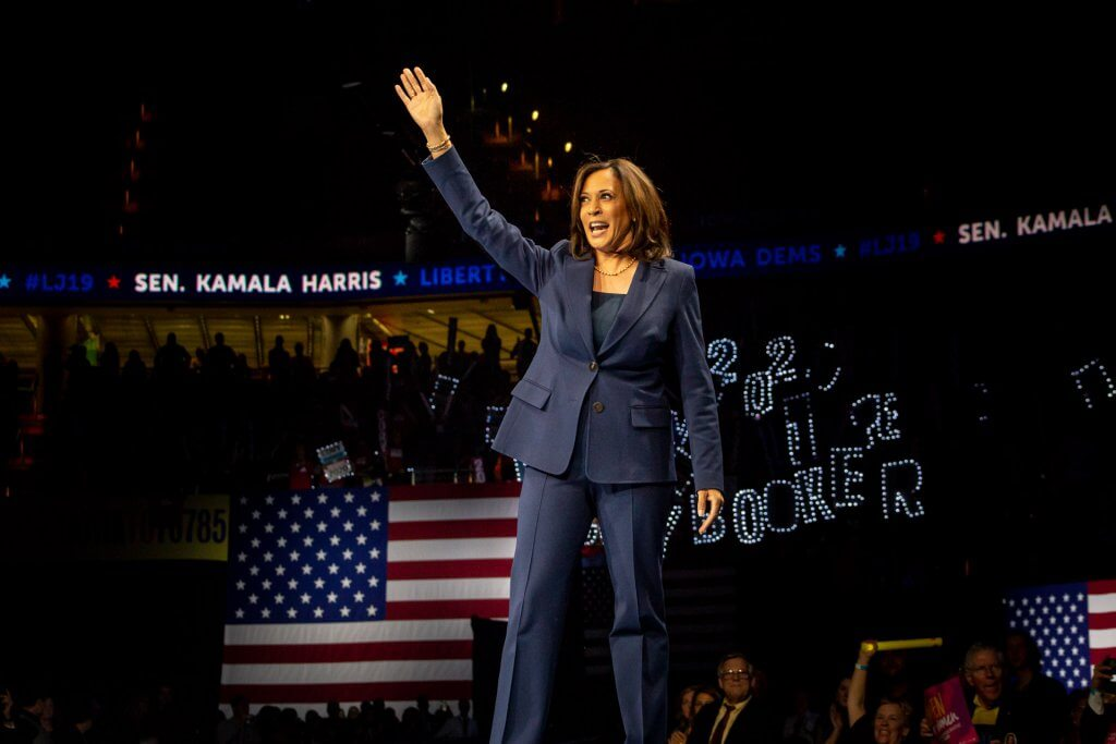 Photo of US Senator Kamala Harris walking on stage at the 2019 Liberty & Justice Celebration in Des Moines, IA.