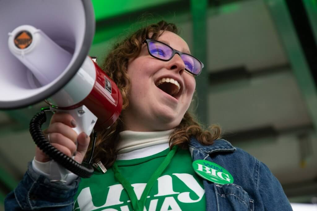 Photo of a staffer for US Senator Amy Klobuchar's presidential campaign holding a megaphone